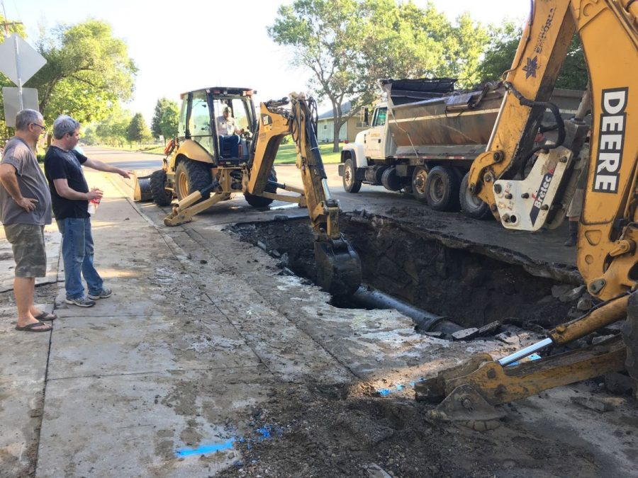Workers fixing the water pipe in Emporia. Source: Emporia Gazette