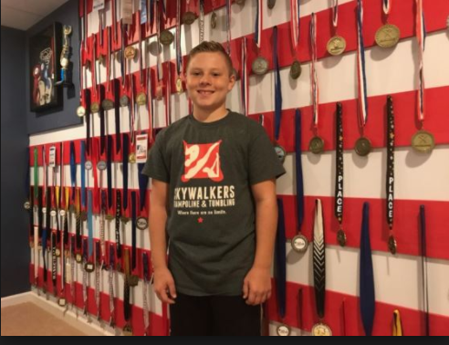 Braxton Higgins next to some of his medals.