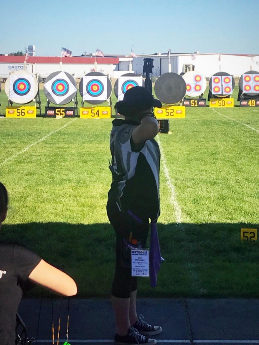 Archer competes at NFAA Outdoor Championship in Yankton, South Dakota.