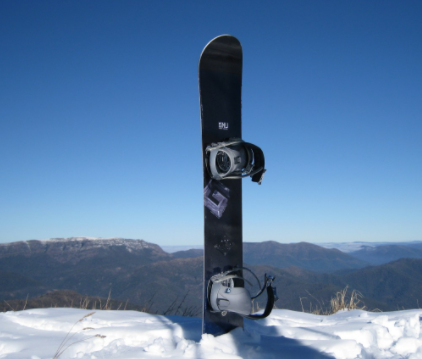 This is a snow board at the top of a mountain.